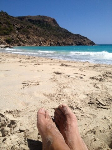 St. Barths beach and foot in the sand photo by Iron MusicVEVO